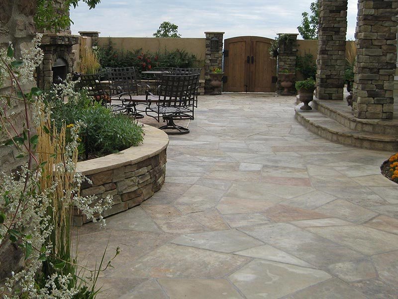 Courtyard with stucco walls, raised planting beds, and flagstone patio.